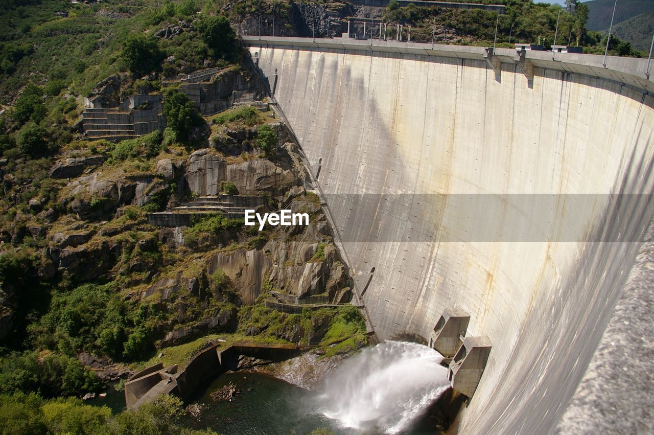 High Angle View Of Dam By River