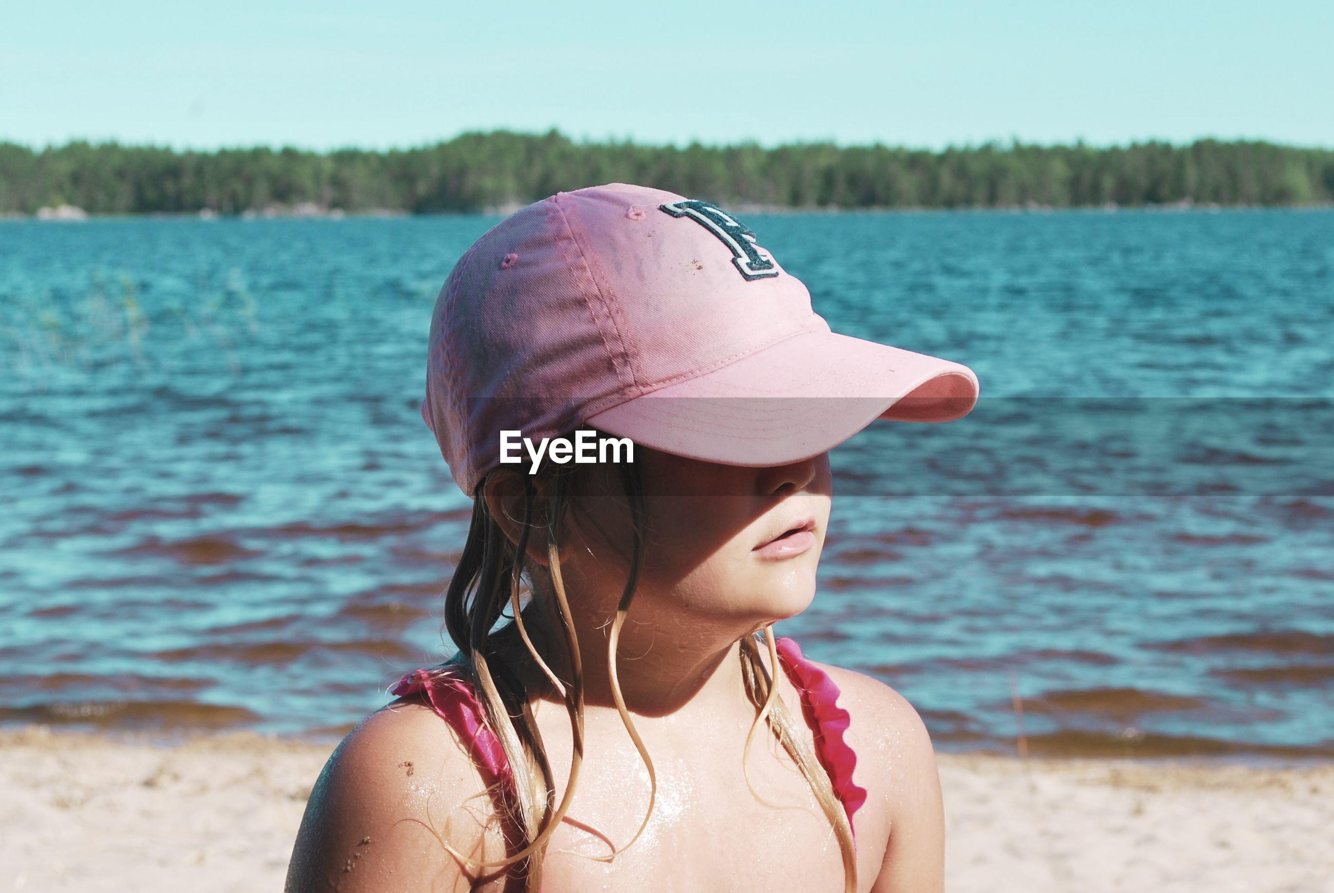 Close-up of girl wearing cap at beach