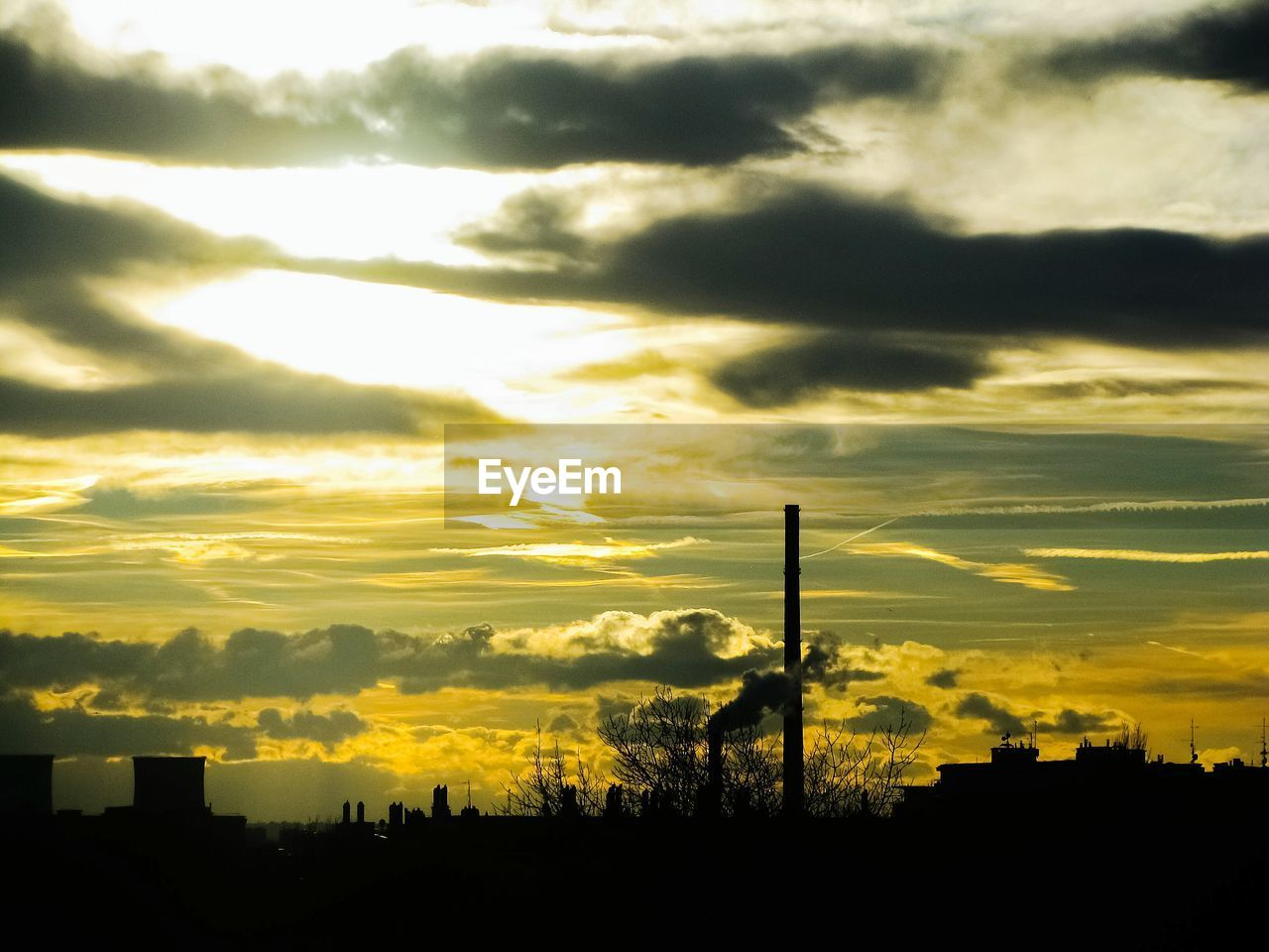 cloud - sky, sky, sunset, silhouette, architecture, built structure, building exterior, no people, smoke stack, nature, factory, industry, beauty in nature, orange color, outdoors, building, city, dramatic sky, environmental issues, chimney, pollution, air pollution