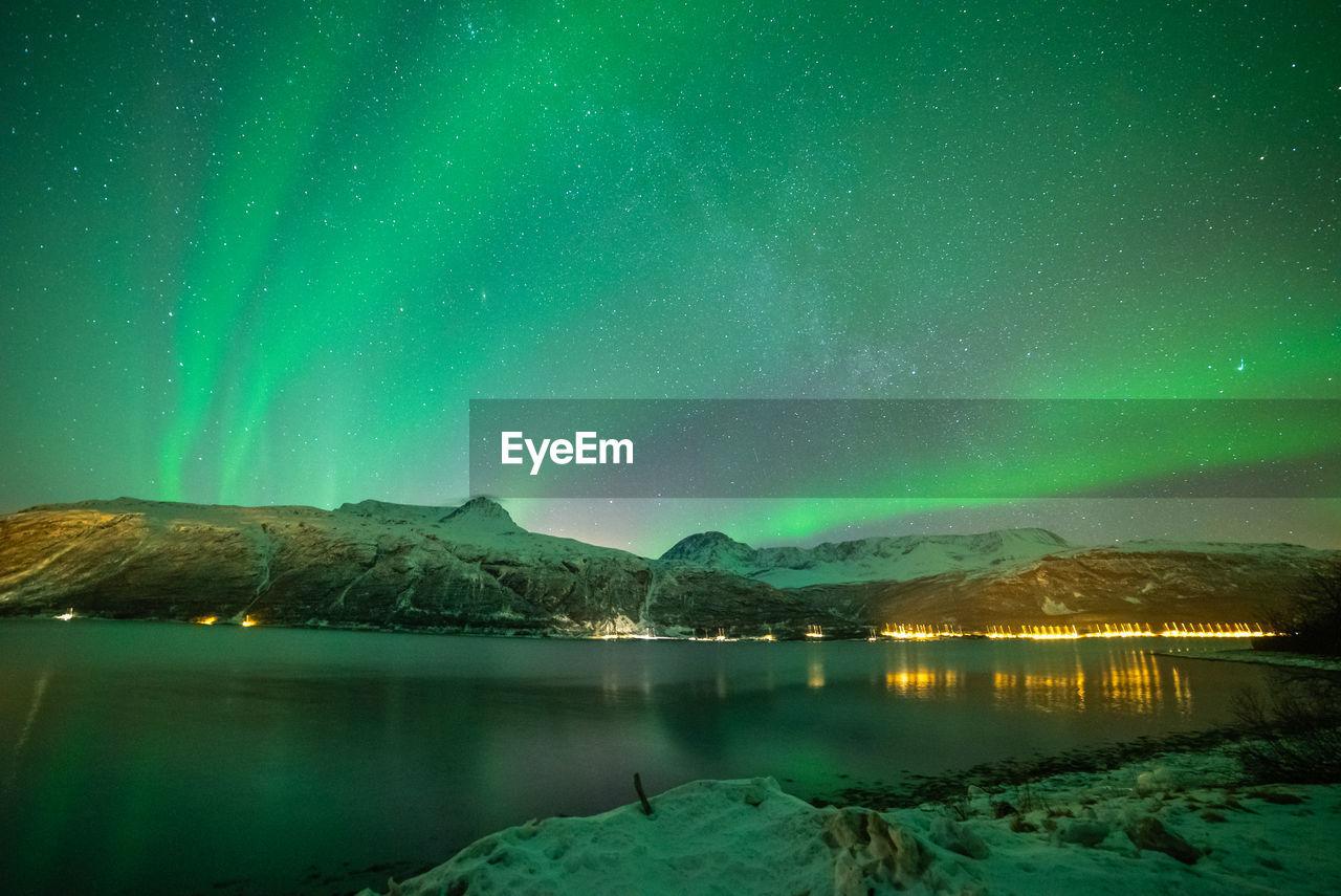 Scenic View Of Lake Against Aurora Borealis During Winter