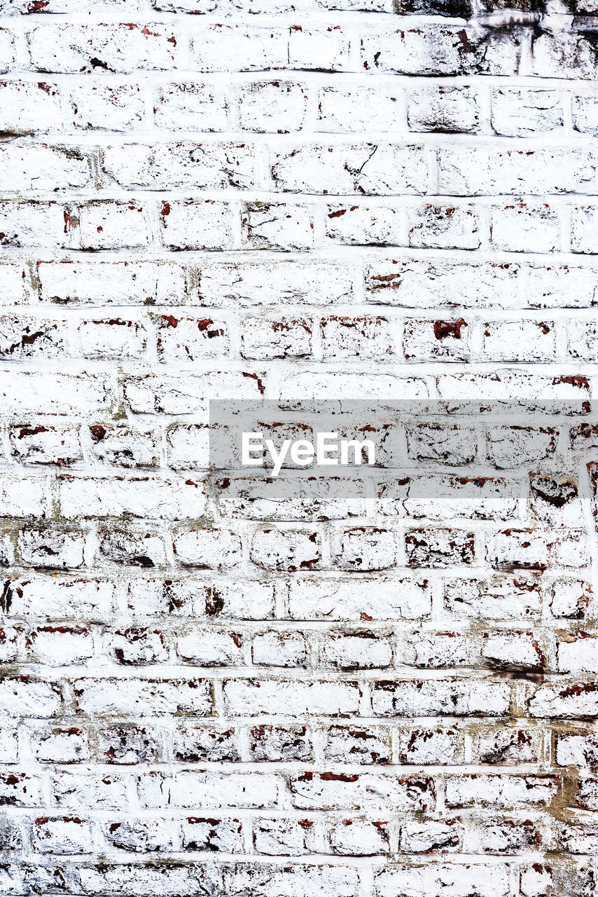 full frame, backgrounds, wall - building feature, pattern, textured, built structure, architecture, wall, no people, brick wall, brick, white color, weathered, day, building exterior, old, text, rough, communication, outdoors, concrete