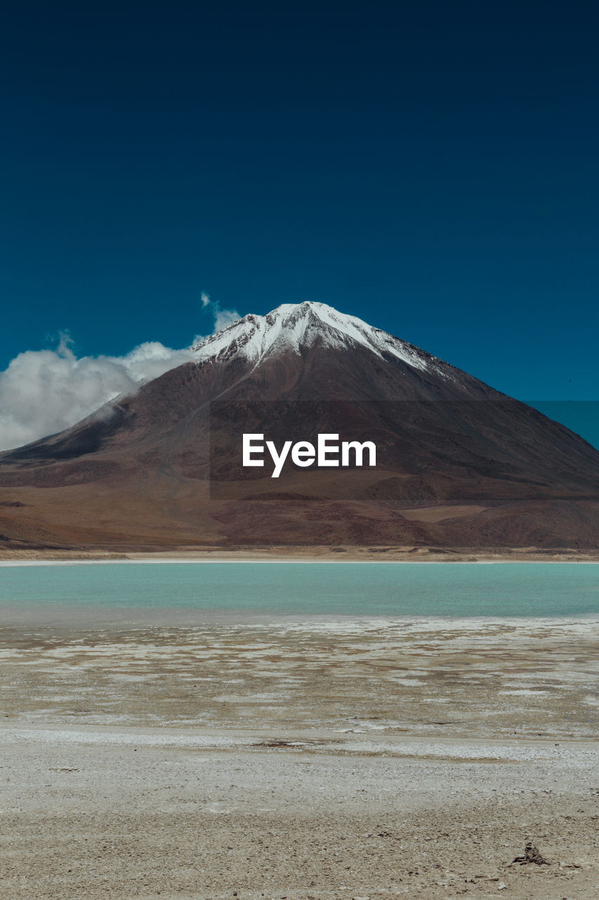 mountain, scenics, tranquil scene, beauty in nature, tranquility, nature, blue, day, landscape, outdoors, no people, mountain range, salt flat, arid climate, salt - mineral, clear sky, sky, water