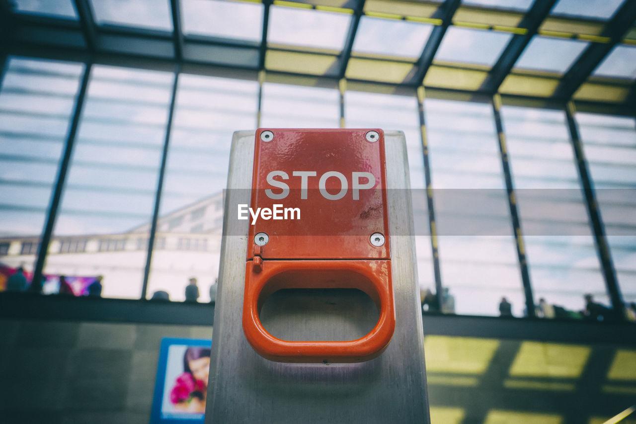 Close-Up Of Stop Text On Emergency Brake At Berlin Potsdamer Platz