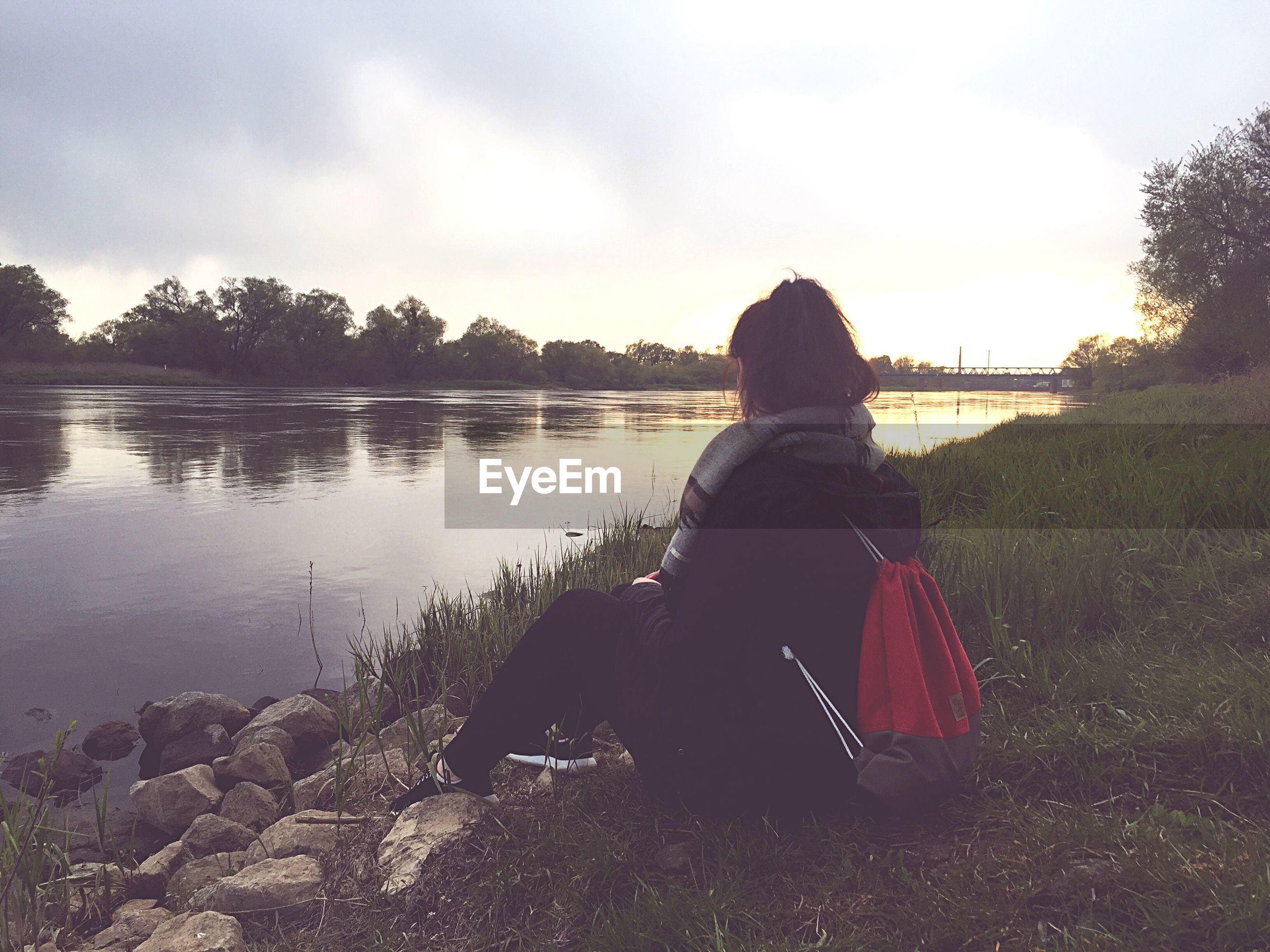 water, sky, rear view, lifestyles, leisure activity, lake, tranquility, sitting, tranquil scene, cloud - sky, men, nature, standing, beauty in nature, scenics, person, relaxation, cloud