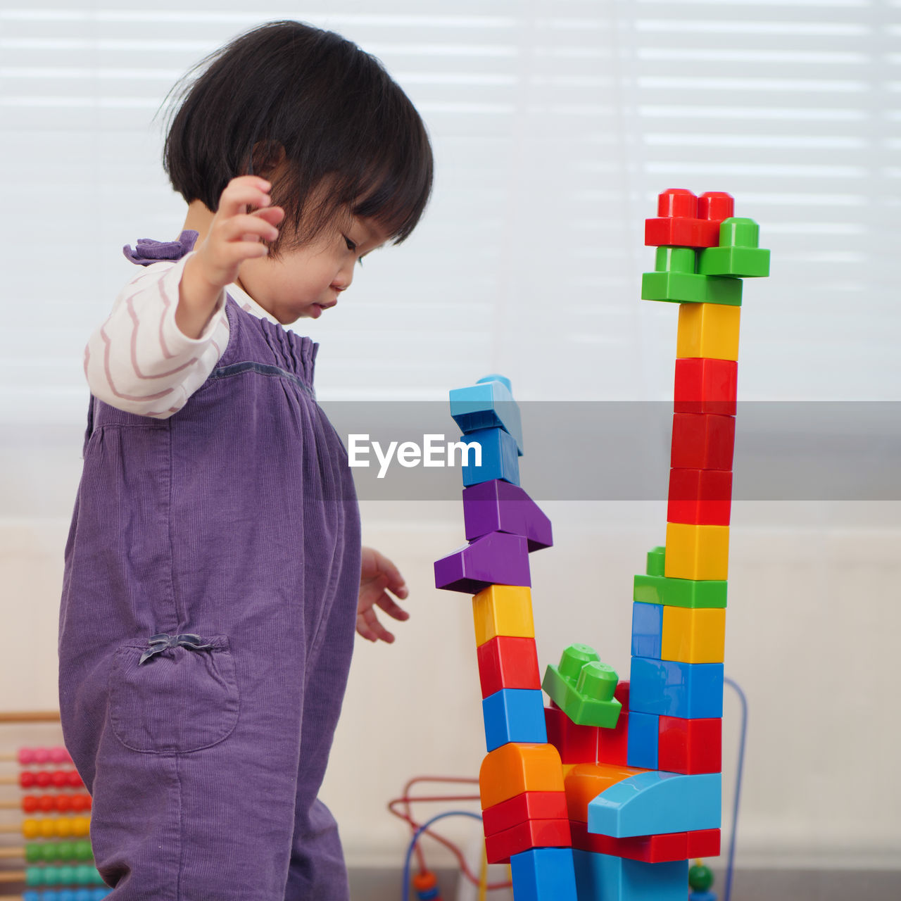 Baby Girl Playing With Toy Blocks