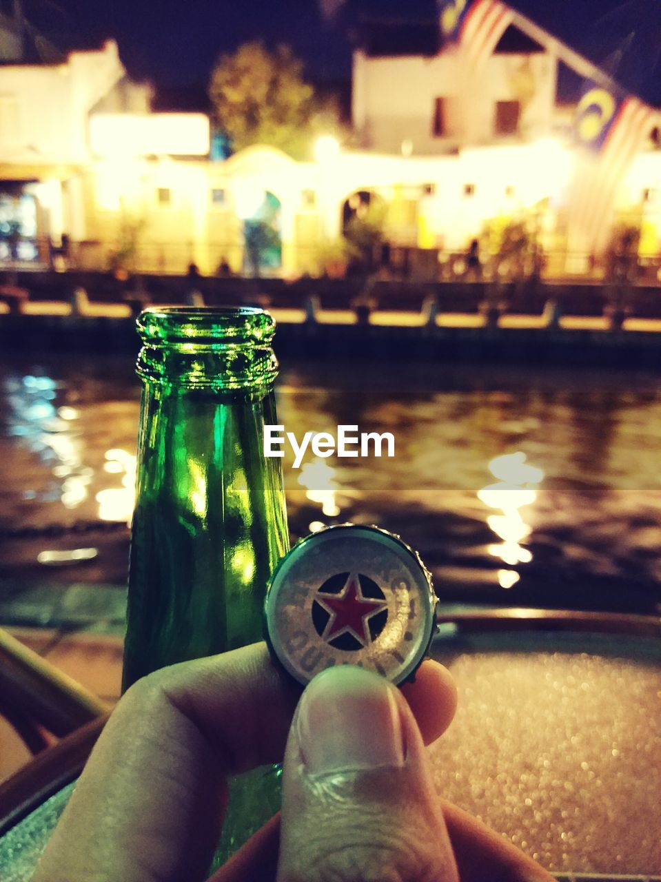 human hand, human body part, human finger, one person, real people, personal perspective, focus on foreground, close-up, unrecognizable person, drink, holding, food and drink, refreshment, night, leisure activity, drinking glass, water, lifestyles, outdoors, low section, freshness, sky, nail polish, people