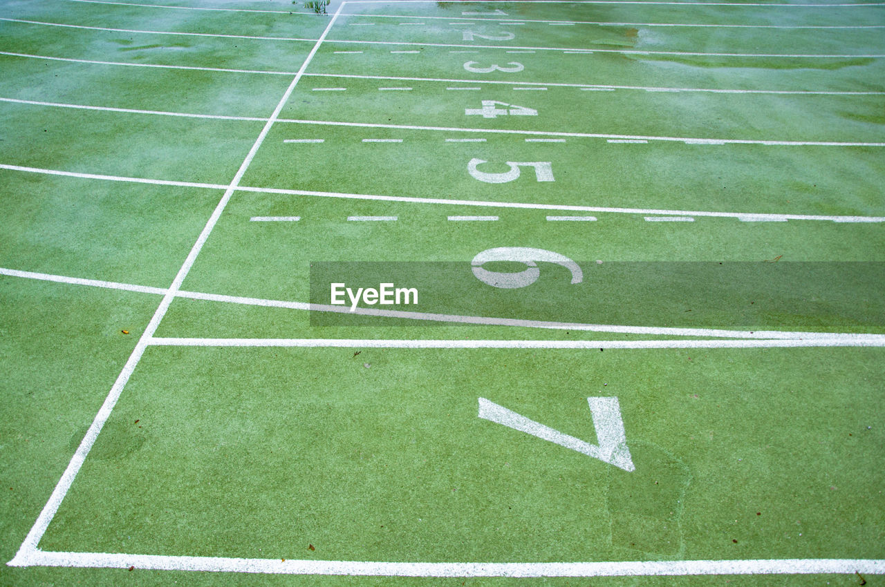 sport, grass, number, competition, playing field, no people, american football field, american football - sport, green color, american football - ball, outdoors, competitive sport, stadium, nature, day, close-up, plant, backgrounds, full frame, turf, yard line - sport, dividing line