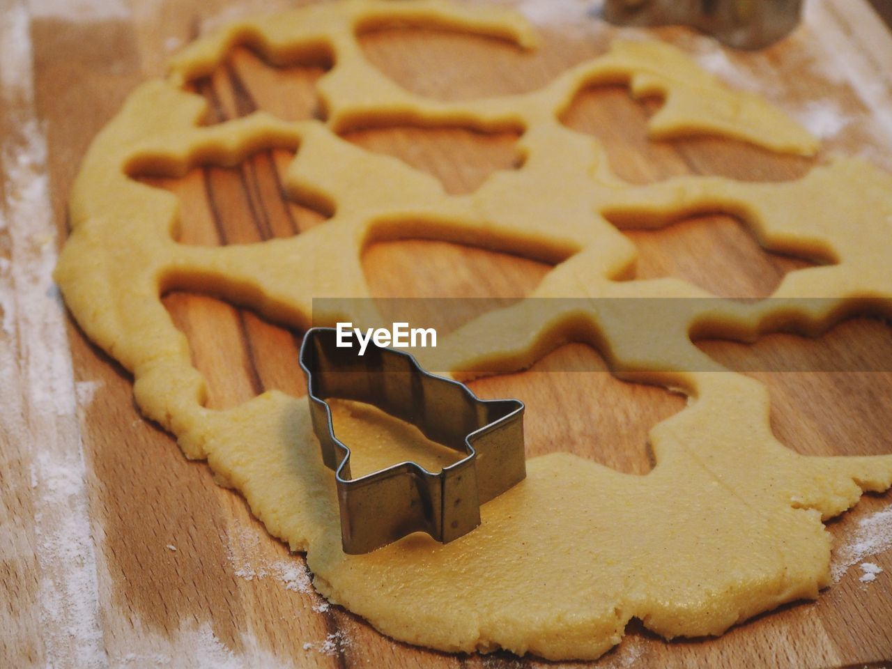 cookie, baked, food, food and drink, sweet food, still life, indoors, freshness, shape, preparation, star shape, dough, table, christmas, pastry cutter, close-up, no people, design, holiday, high angle view, gingerbread cookie, temptation, preparing food