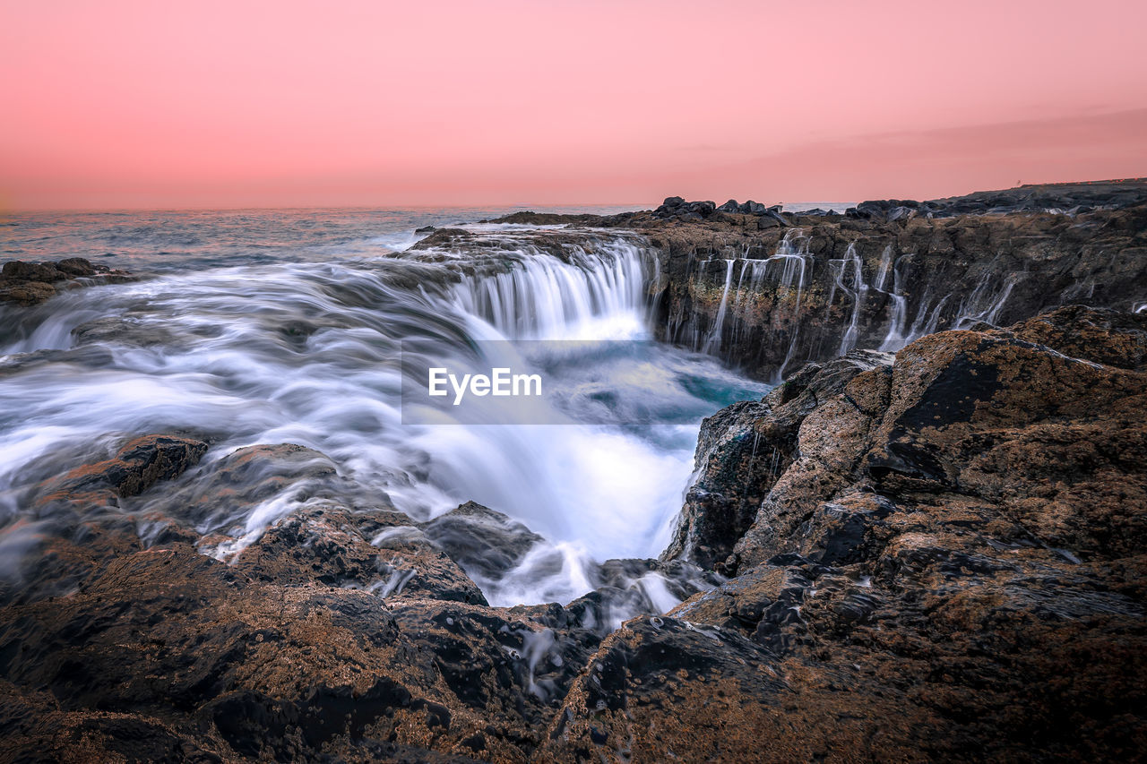 scenics - nature, beauty in nature, sunset, water, sky, motion, sea, long exposure, rock, rock - object, solid, nature, blurred motion, idyllic, no people, non-urban scene, waterfall, flowing water, tranquil scene, power in nature, outdoors, horizon over water, flowing