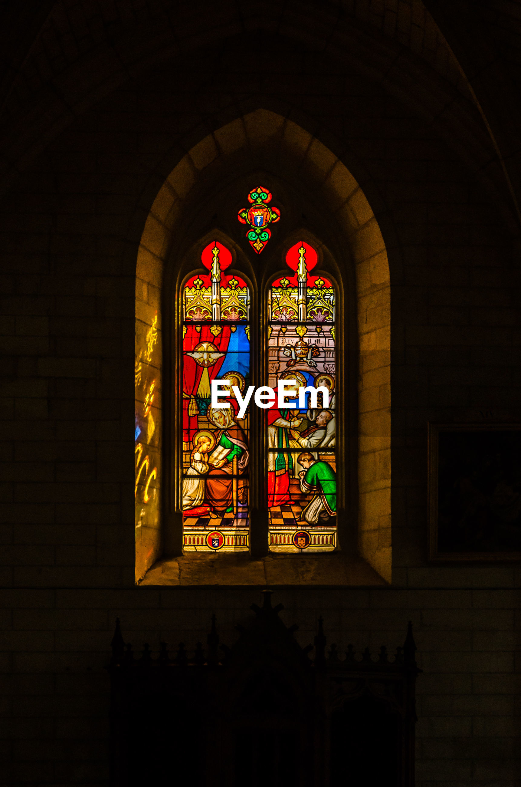 COLORFUL WINDOW IN CHURCH