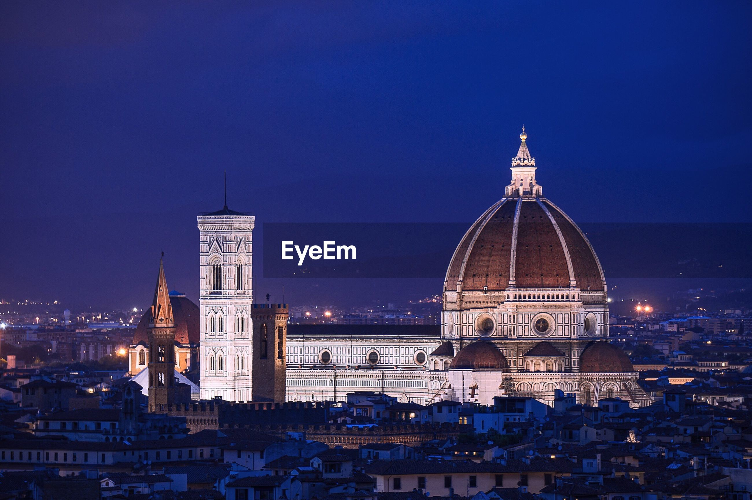 Florence cathedral in city at night