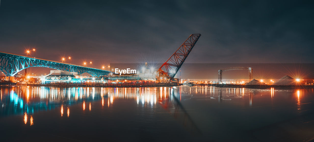 night, waterfront, sky, reflection, water, illuminated, built structure, architecture, bridge - man made structure, no people, outdoors, industry, transportation, travel destinations, building exterior, sea, nautical vessel, nature, beauty in nature, city