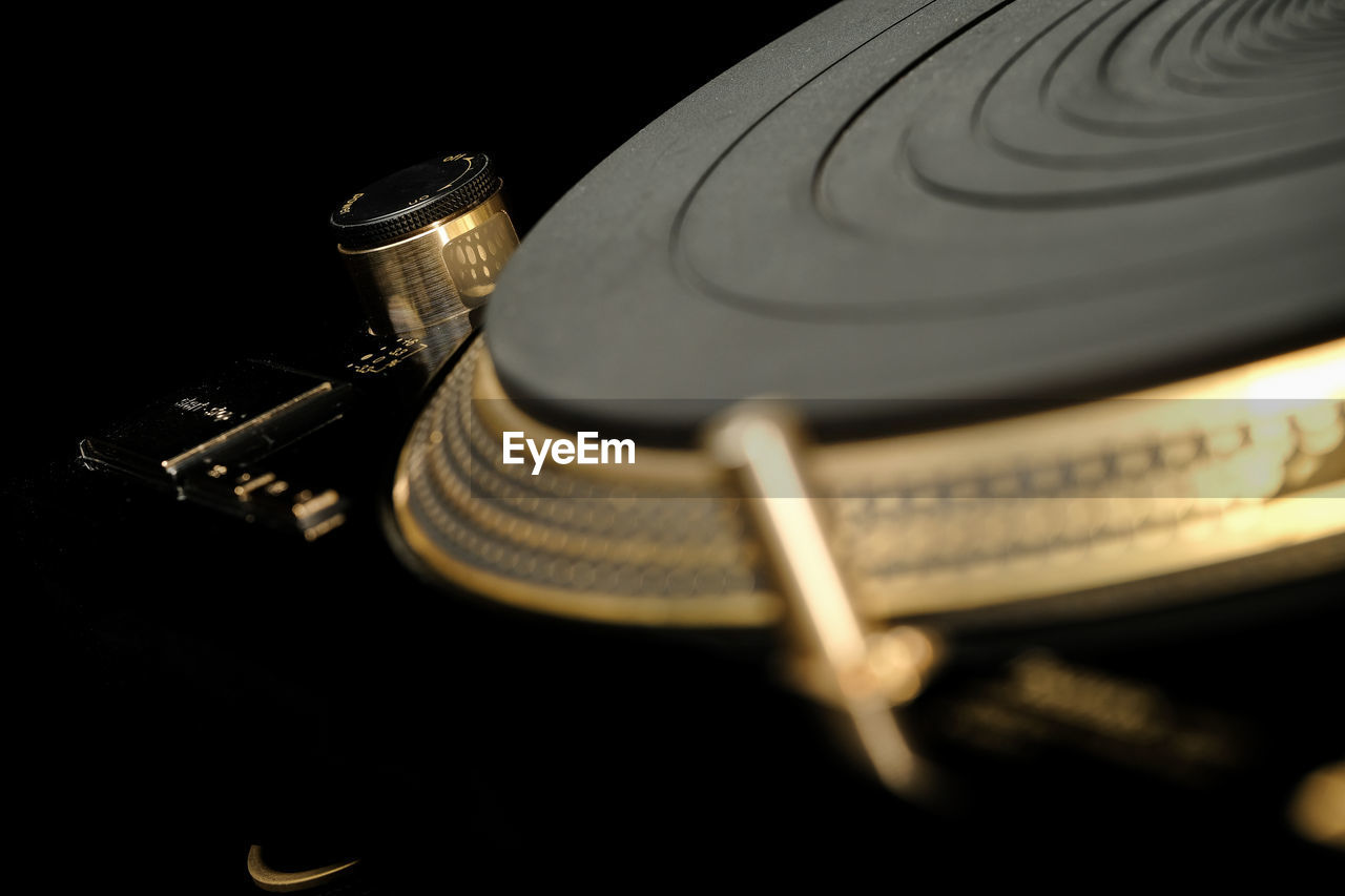 music, close-up, turntable, technology, selective focus, indoors, no people, musical instrument, arts culture and entertainment, record, still life, retro styled, listening, studio shot, audio equipment, black background, musical equipment, equipment, record player needle, antique, electrical equipment