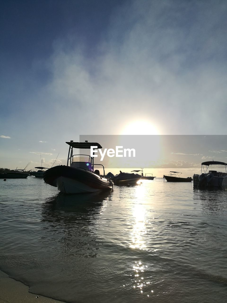 water, sky, nautical vessel, transportation, sunset, sun, mode of transportation, sea, cloud - sky, beauty in nature, waterfront, scenics - nature, reflection, nature, sunlight, tranquility, tranquil scene, no people, outdoors, lens flare, bright