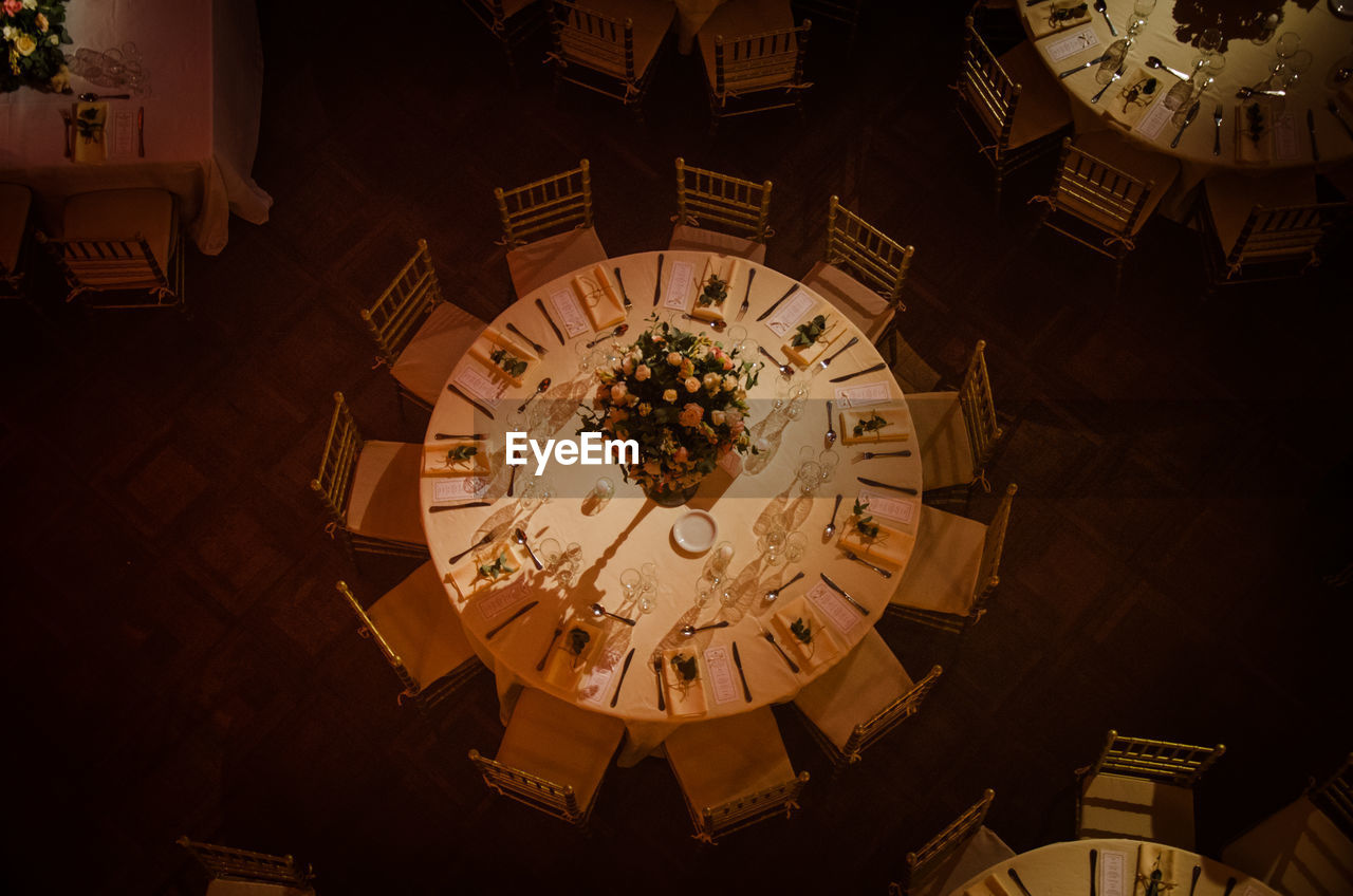 Directly Above Shot Of Chairs And Table Arranged At Restaurant