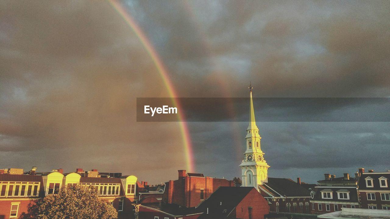 architecture, building exterior, built structure, cloud - sky, sky, rainbow, city, no people, cityscape, storm cloud, outdoors, travel destinations, day, nature, multi colored