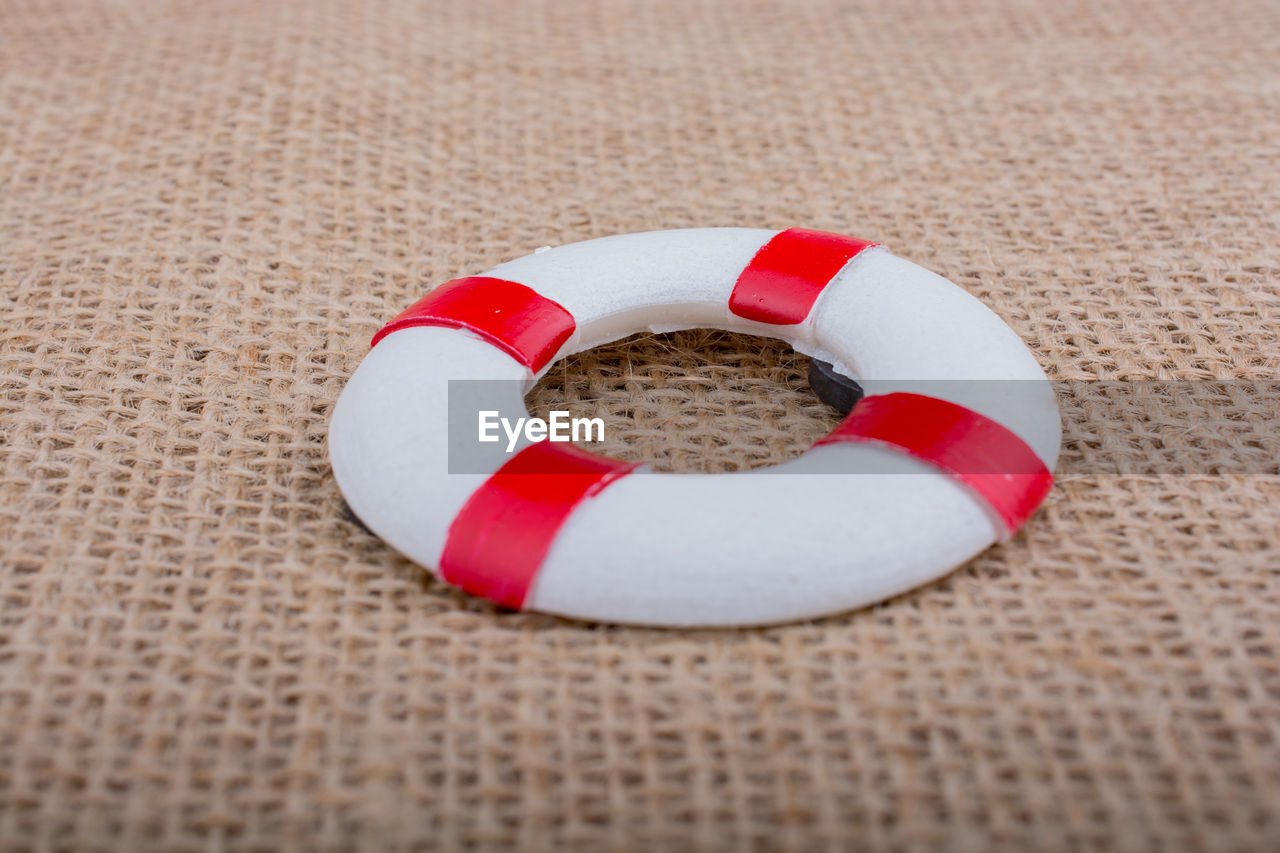circle, red, geometric shape, no people, close-up, still life, shape, love, indoors, high angle view, security, safety, emotion, jewelry, heart shape, positive emotion, two objects, white color, design, food
