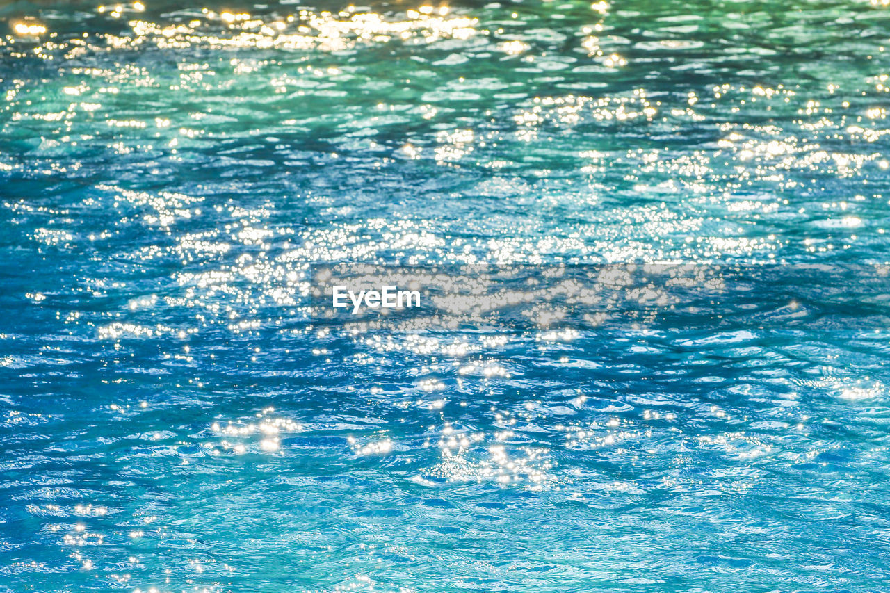 water, blue, waterfront, backgrounds, full frame, no people, sea, day, nature, beauty in nature, reflection, motion, swimming pool, outdoors, pool, tranquility, sunlight, rippled, scenics - nature, turquoise colored, purity