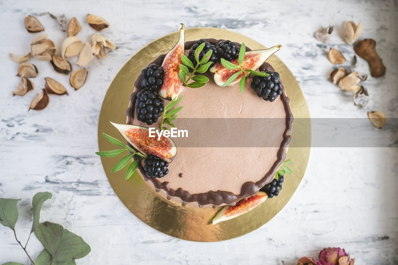 food and drink, food, freshness, table, still life, indoors, high angle view, leaf, ready-to-eat, healthy eating, plant part, no people, fruit, wellbeing, indulgence, plate, herb, close-up, focus on foreground, directly above, temptation