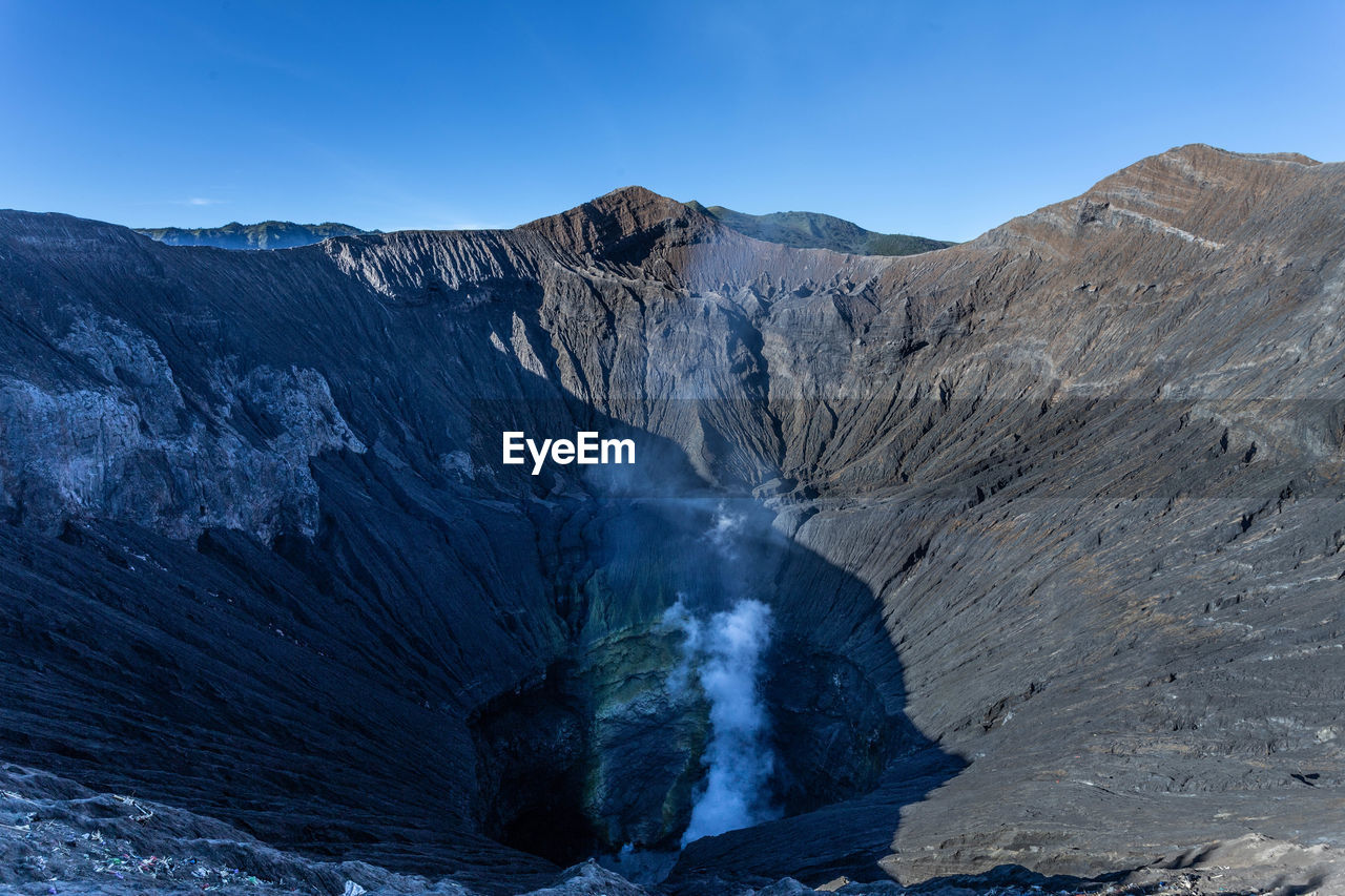 Scenic view of volcanic mount bromo against sky