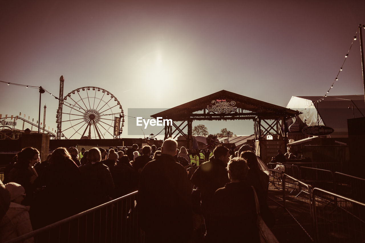 large group of people, real people, men, leisure activity, sunset, women, arts culture and entertainment, fun, sky, enjoyment, outdoors, lifestyles, built structure, crowd, day, people