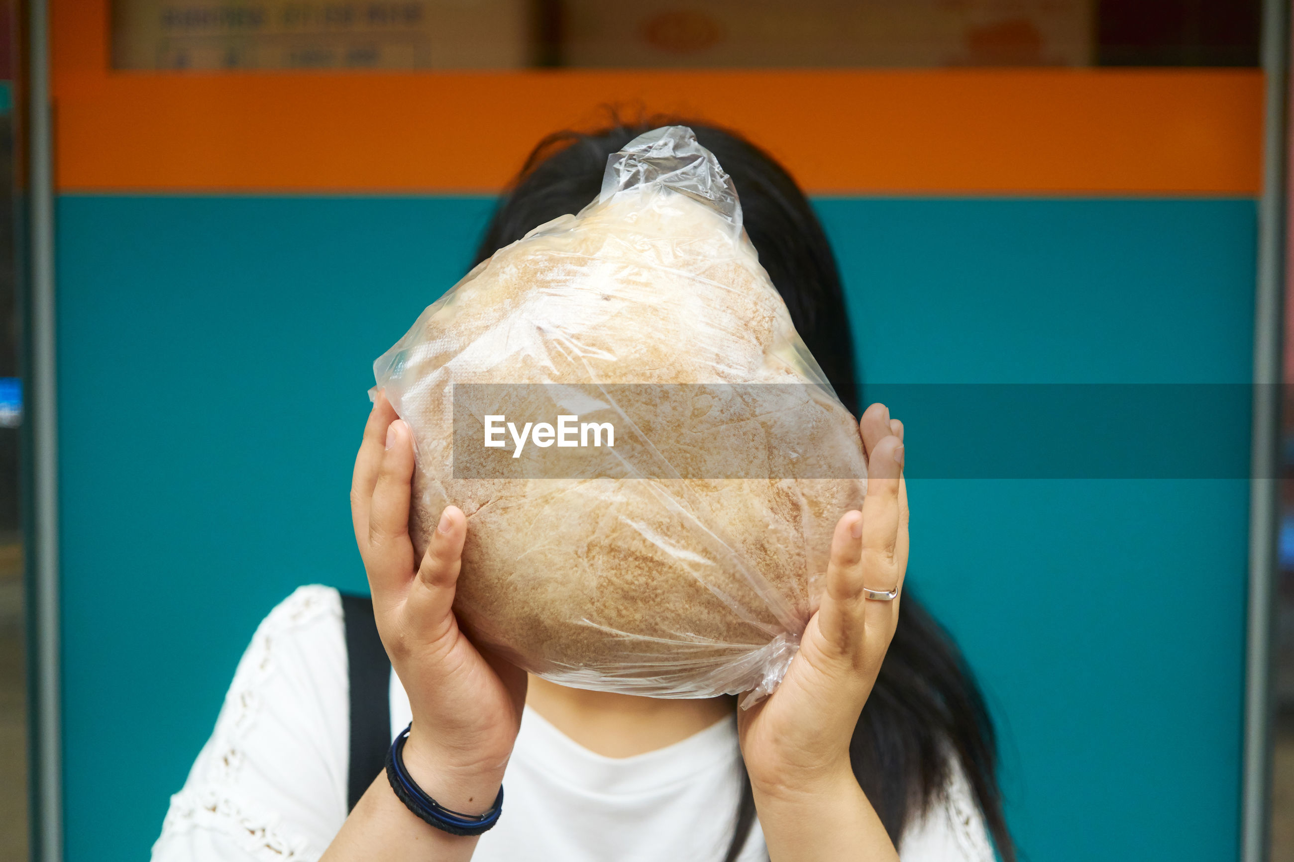 Woman covering face with food