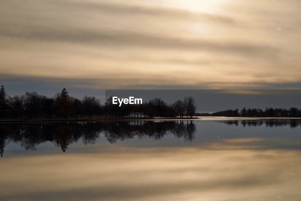reflection, water, sunset, sky, beauty in nature, cloud - sky, nature, tranquil scene, lake, scenics, tranquility, tree, no people, outdoors, travel destinations, day