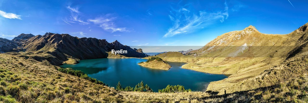 sky, scenics - nature, mountain, tranquil scene, beauty in nature, tranquility, water, cloud - sky, landscape, non-urban scene, nature, environment, idyllic, blue, mountain range, no people, day, remote, lake, formation, turquoise colored