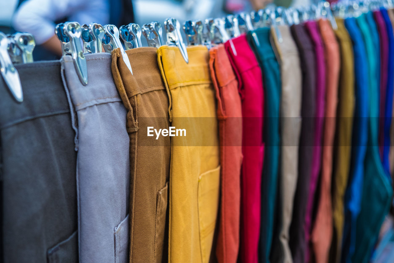 Multi colored pants hanging for sale in store