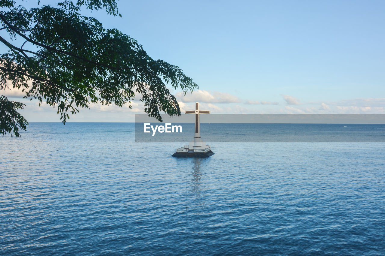 water, sea, sky, waterfront, beauty in nature, scenics - nature, tranquil scene, tranquility, tree, day, horizon over water, nature, no people, nautical vessel, horizon, plant, non-urban scene, blue, guidance, outdoors