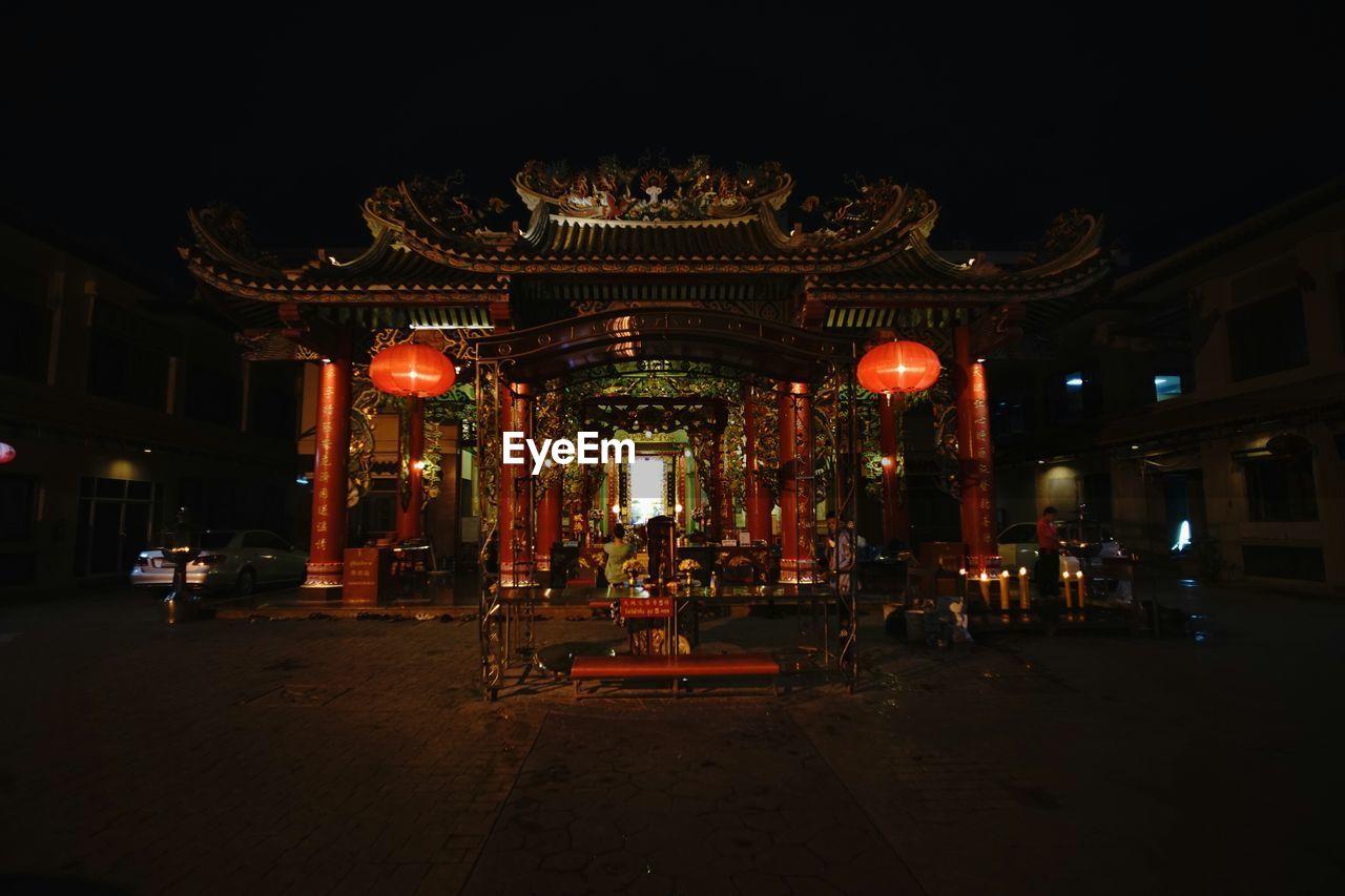 Illuminated temple at night