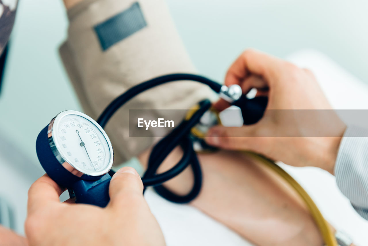 Cropped image of doctor examining patient