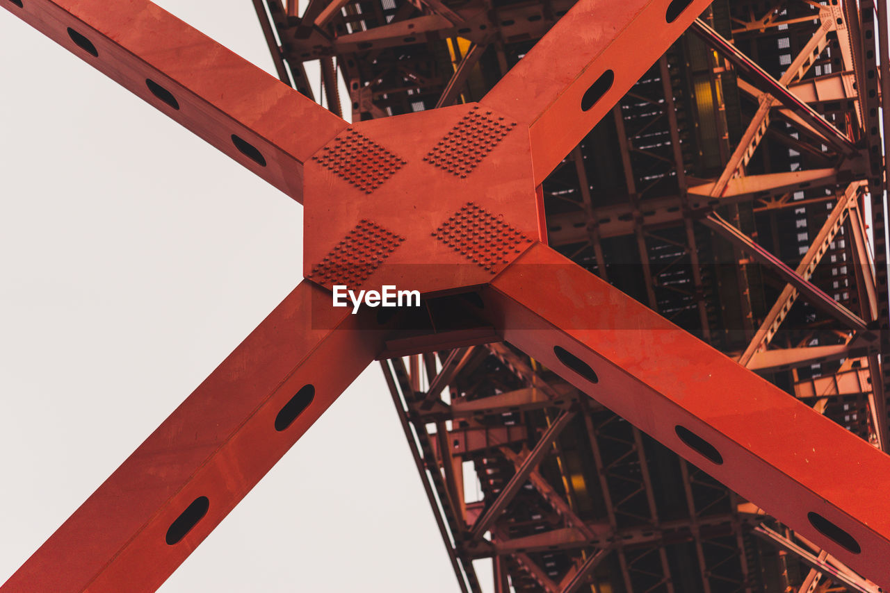 metal, machinery, red, no people, industry, sky, day, nature, low angle view, construction industry, close-up, architecture, built structure, crane - construction machinery, orange color, outdoors, connection, construction site, machine part, transportation, girder, industrial equipment, alloy, wheel