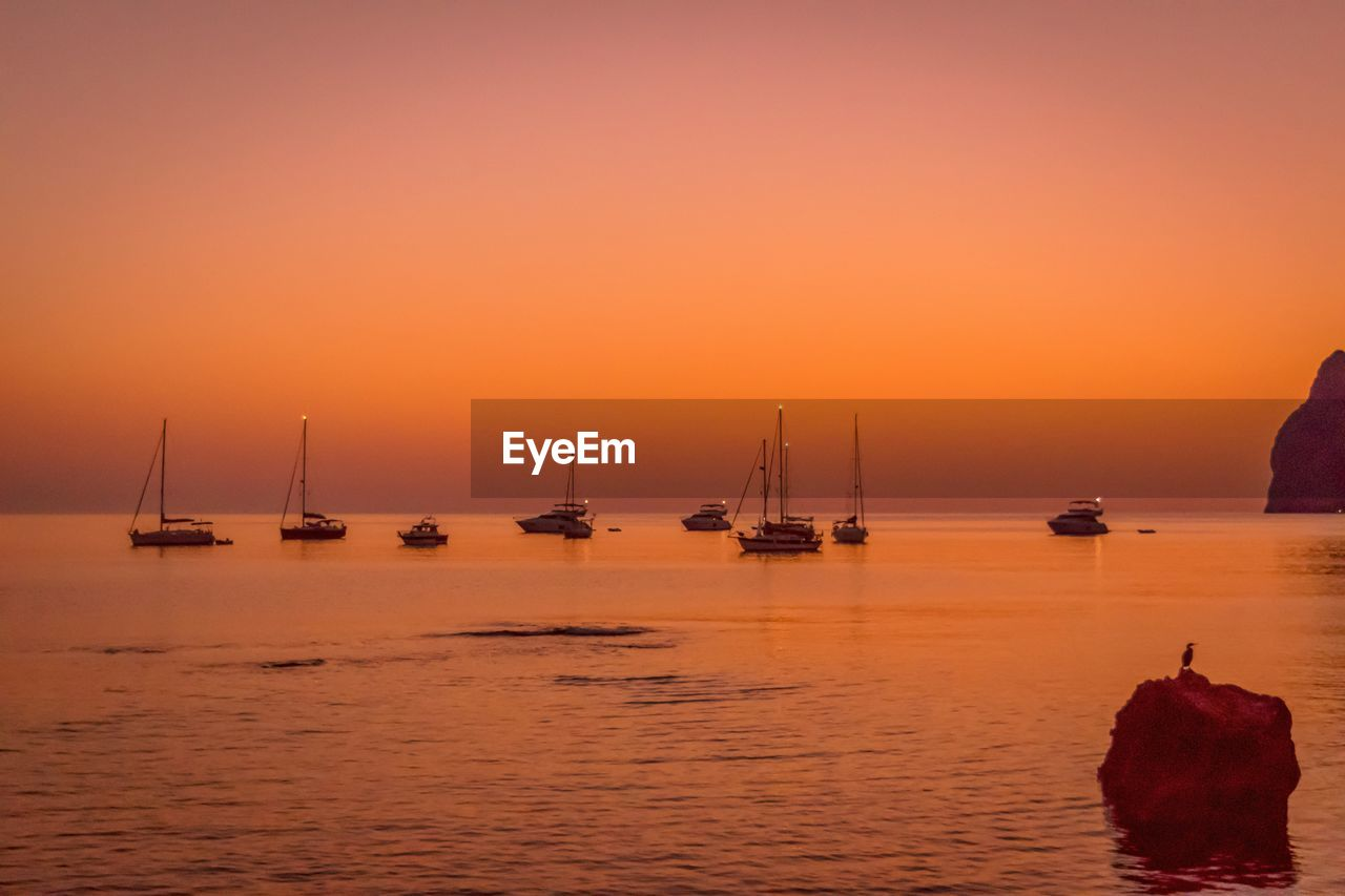 water, sunset, sea, sky, transportation, orange color, beauty in nature, nautical vessel, mode of transportation, scenics - nature, waterfront, sailboat, tranquil scene, tranquility, horizon over water, horizon, idyllic, nature, no people, outdoors
