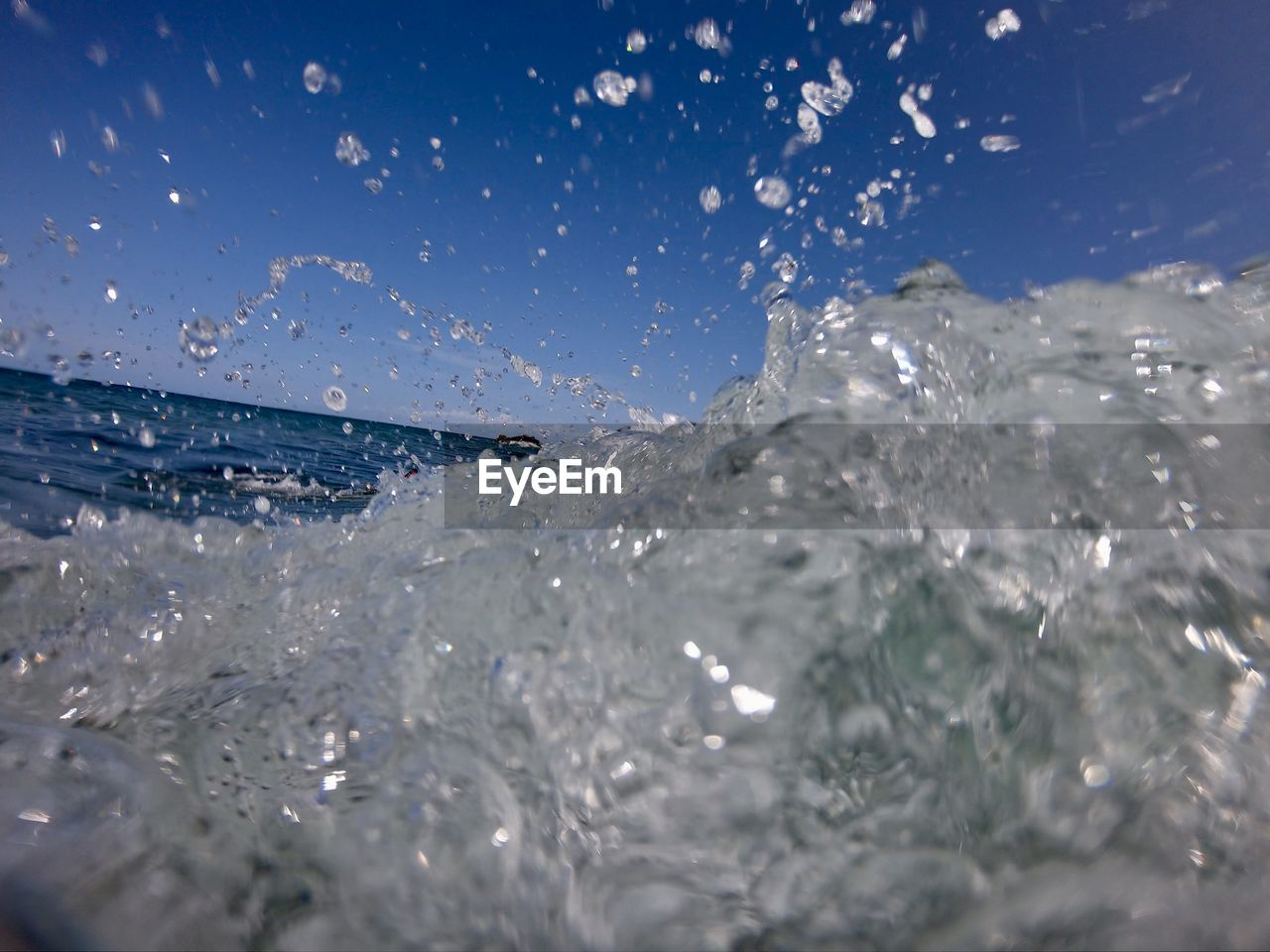 water, motion, splashing, sea, waterfront, nature, day, outdoors, sky, beauty in nature, drop, no people, wave, sport, close-up, blue, aquatic sport, sunlight, scenics - nature, purity