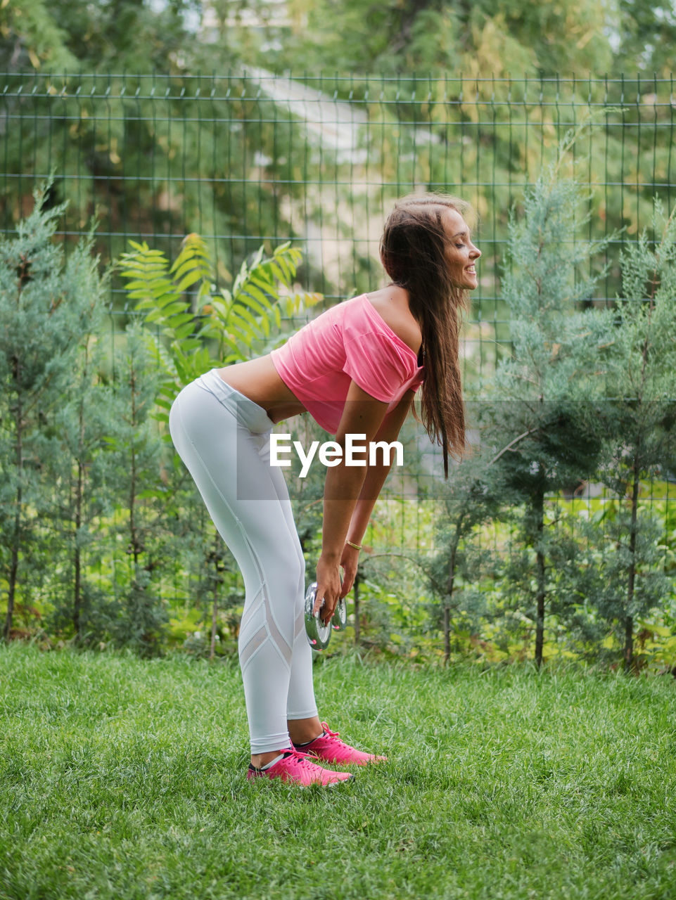 Mid Adult Woman Exercising At Park