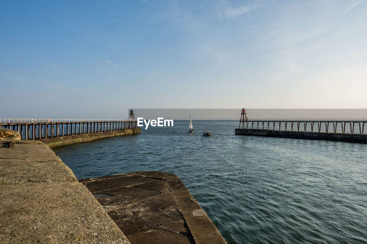 water, sky, sea, beauty in nature, pier, scenics - nature, tranquility, nature, horizon over water, tranquil scene, horizon, architecture, built structure, idyllic, non-urban scene, day, cloud - sky, outdoors, incidental people, promenade