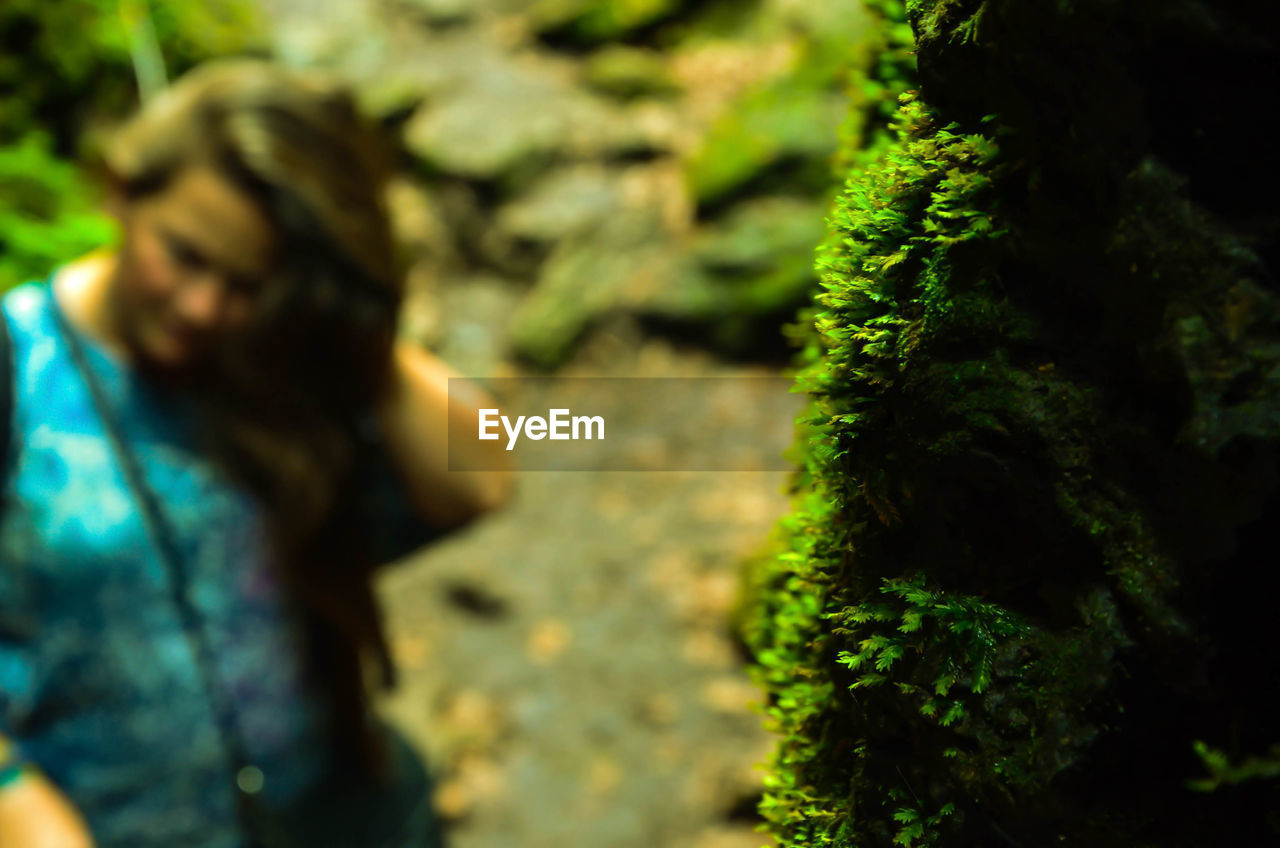green color, nature, plant, outdoors, moss, day, one person, real people, growth, tree, beauty in nature, close-up, people