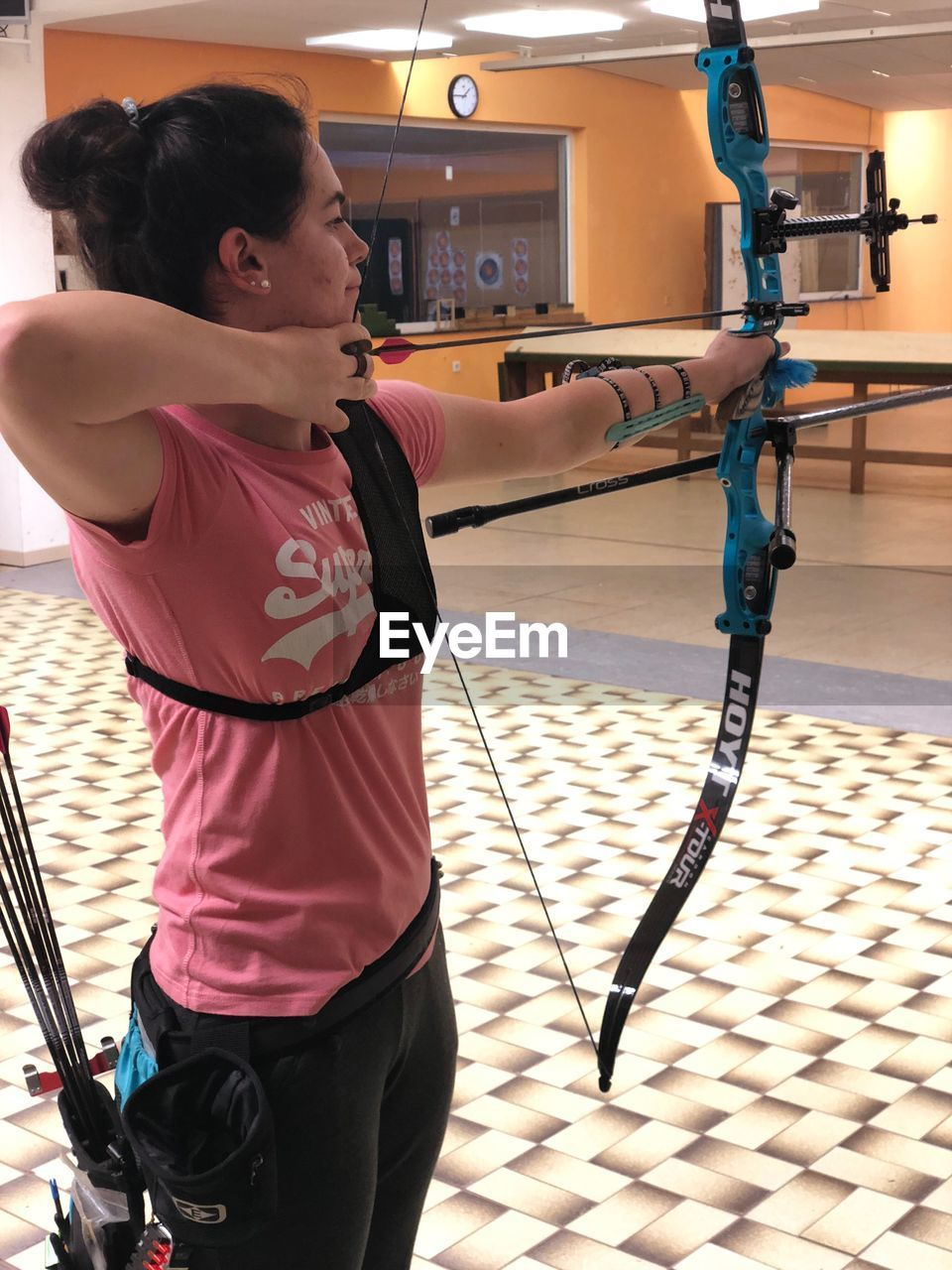 Young Woman Practicing Archery