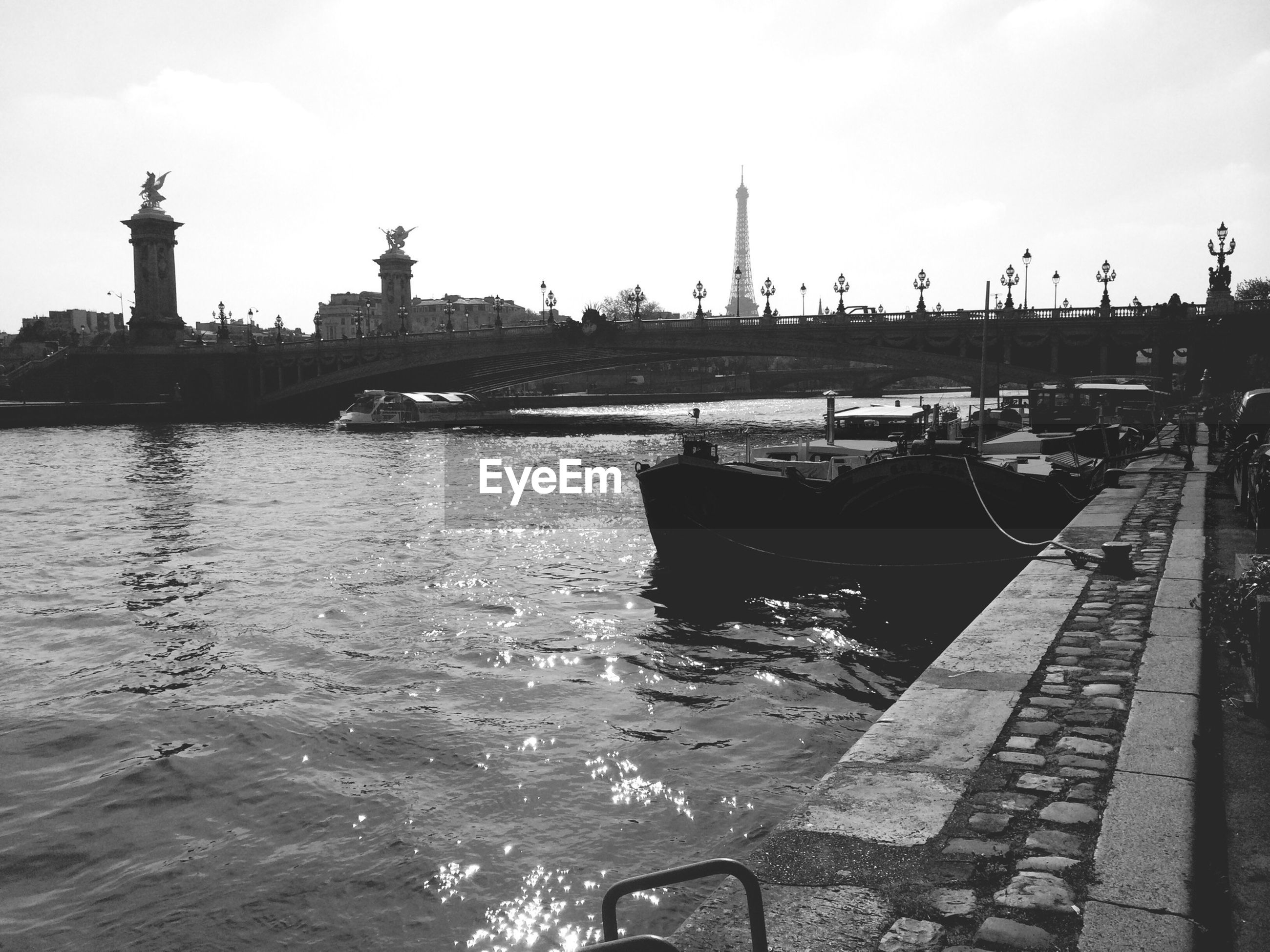 View of river and eiffel tower in background
