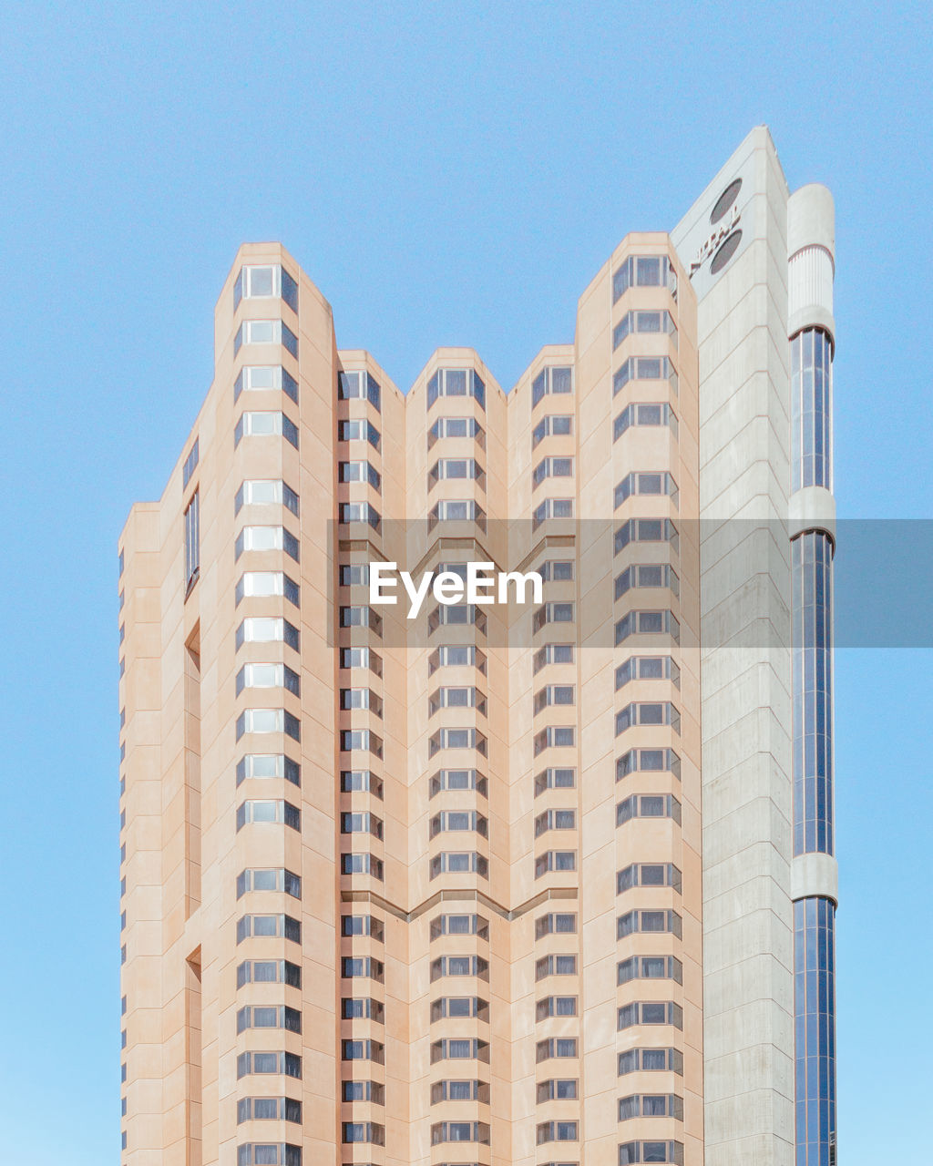 building exterior, architecture, built structure, city, low angle view, tall - high, sky, no people, building, office building exterior, modern, clear sky, day, nature, tower, skyscraper, blue, outdoors, sunlight, window, apartment