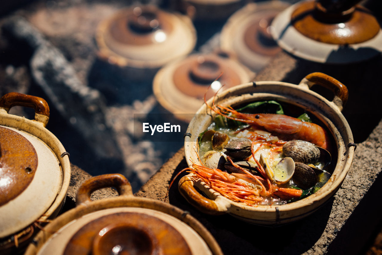 High Angle View Of Seafood In Container On Stove