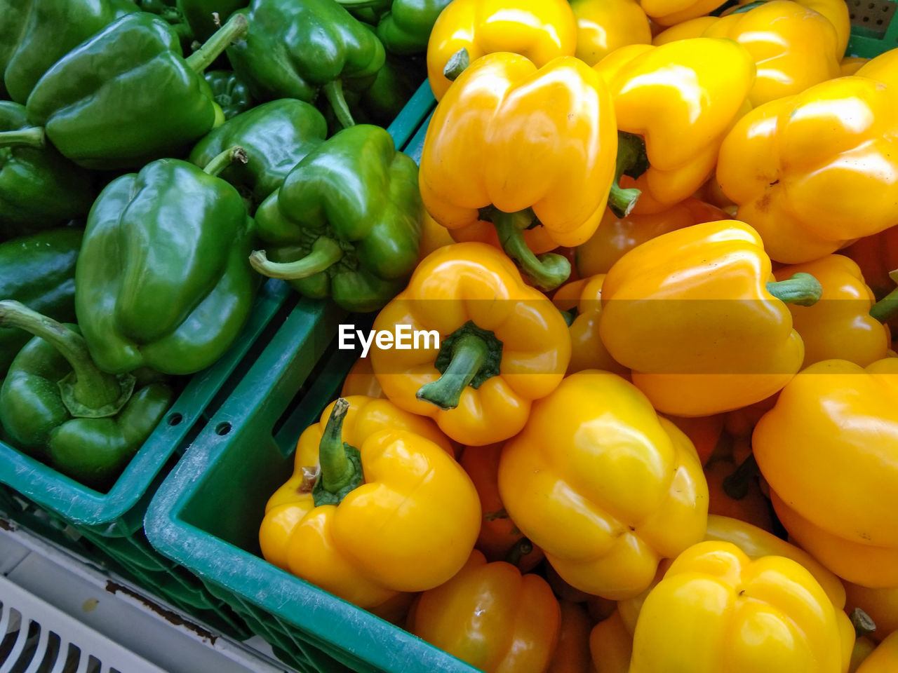 YELLOW BELL PEPPERS FOR SALE IN MARKET STALL