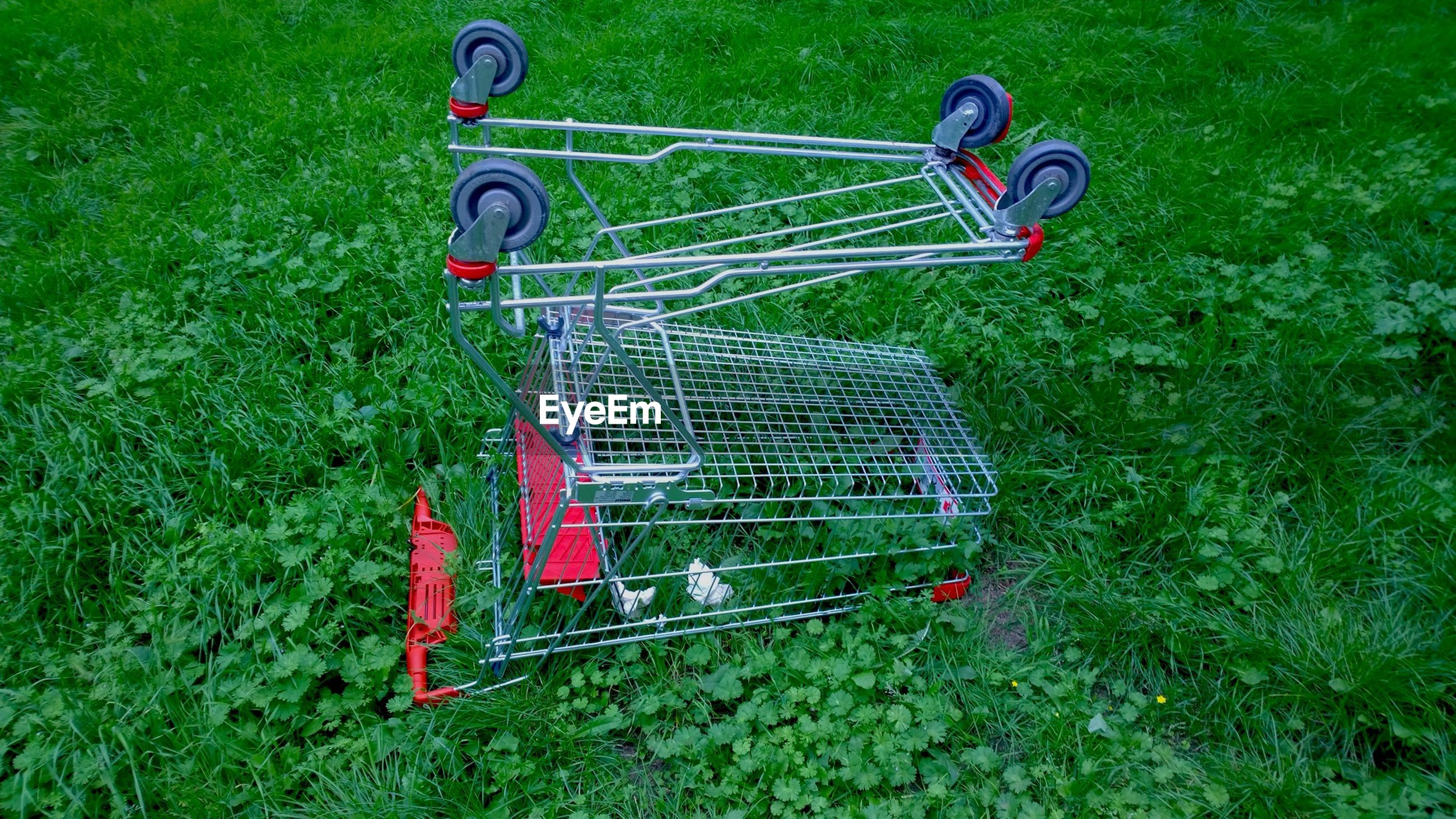 High angle view of shopping cart on grassy field