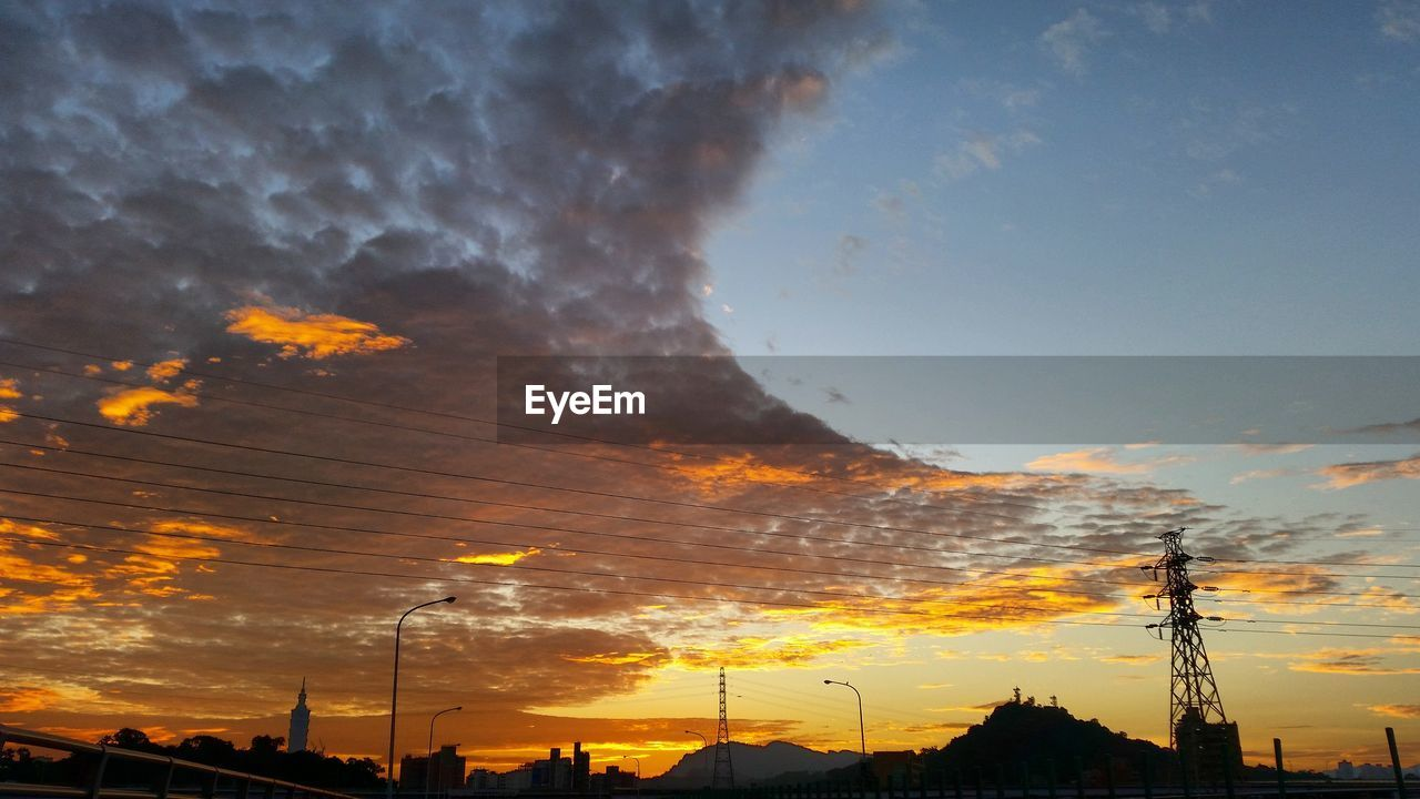 sky, cloud - sky, sunset, silhouette, architecture, built structure, no people, nature, orange color, beauty in nature, building exterior, scenics - nature, technology, low angle view, outdoors, building, fuel and power generation, dramatic sky, tranquil scene, tree, power supply