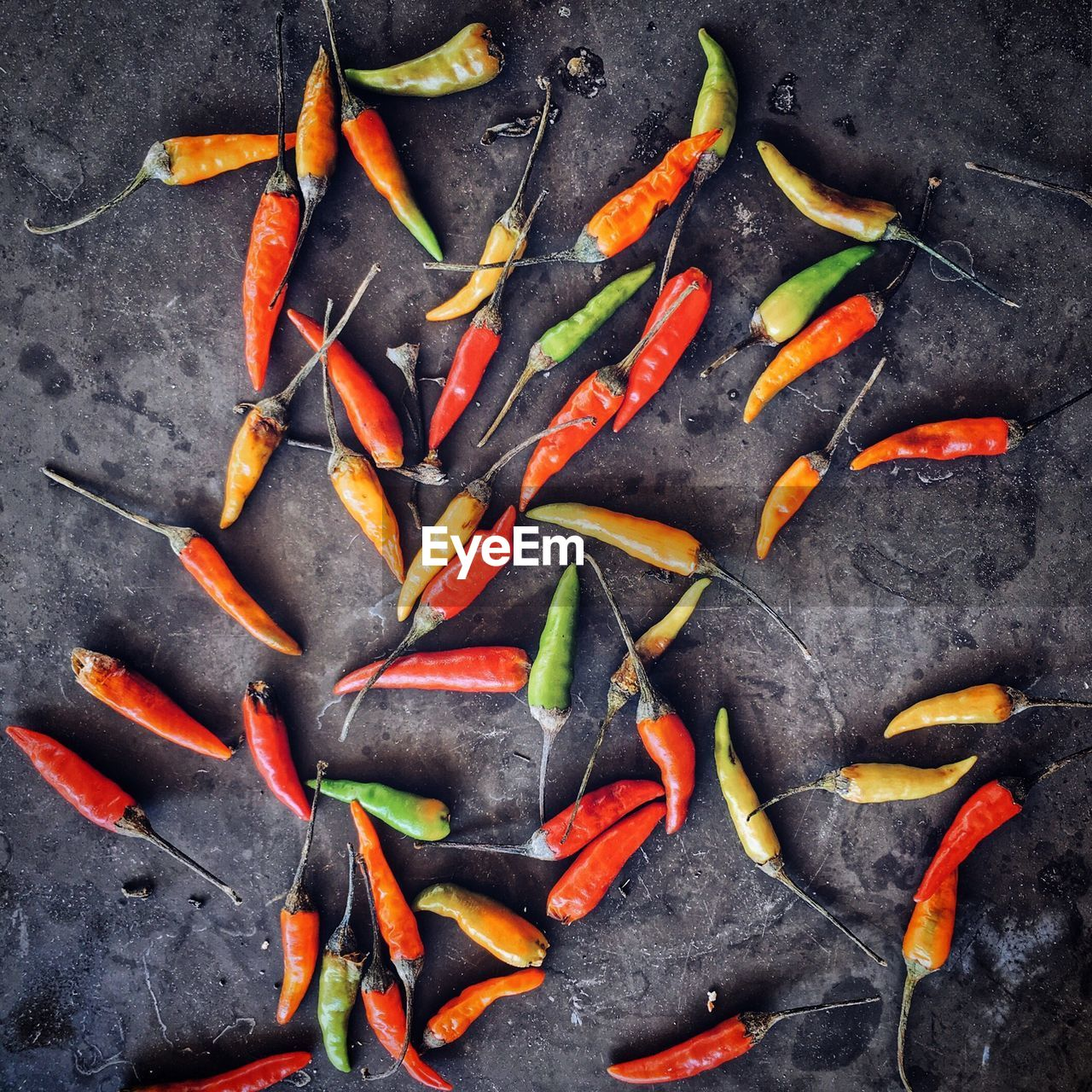 Directly Above Shot Of Chili Peppers On Slate