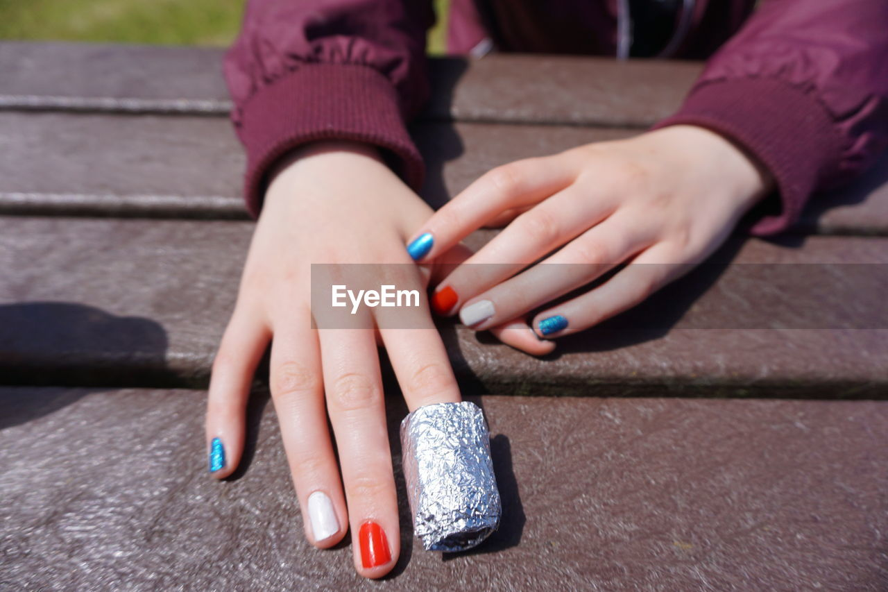Cropped Hands Of Woman With Colorful Painted Nail