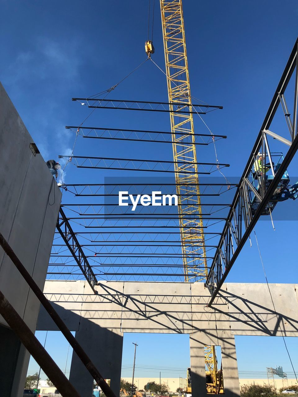 architecture, low angle view, sky, built structure, no people, nature, connection, day, construction industry, building exterior, blue, machinery, cable, development, construction site, crane - construction machinery, bridge, outdoors, bridge - man made structure, industry, skyscraper, power supply