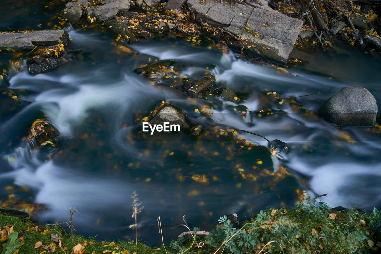 High angle view of stream flowing in lake