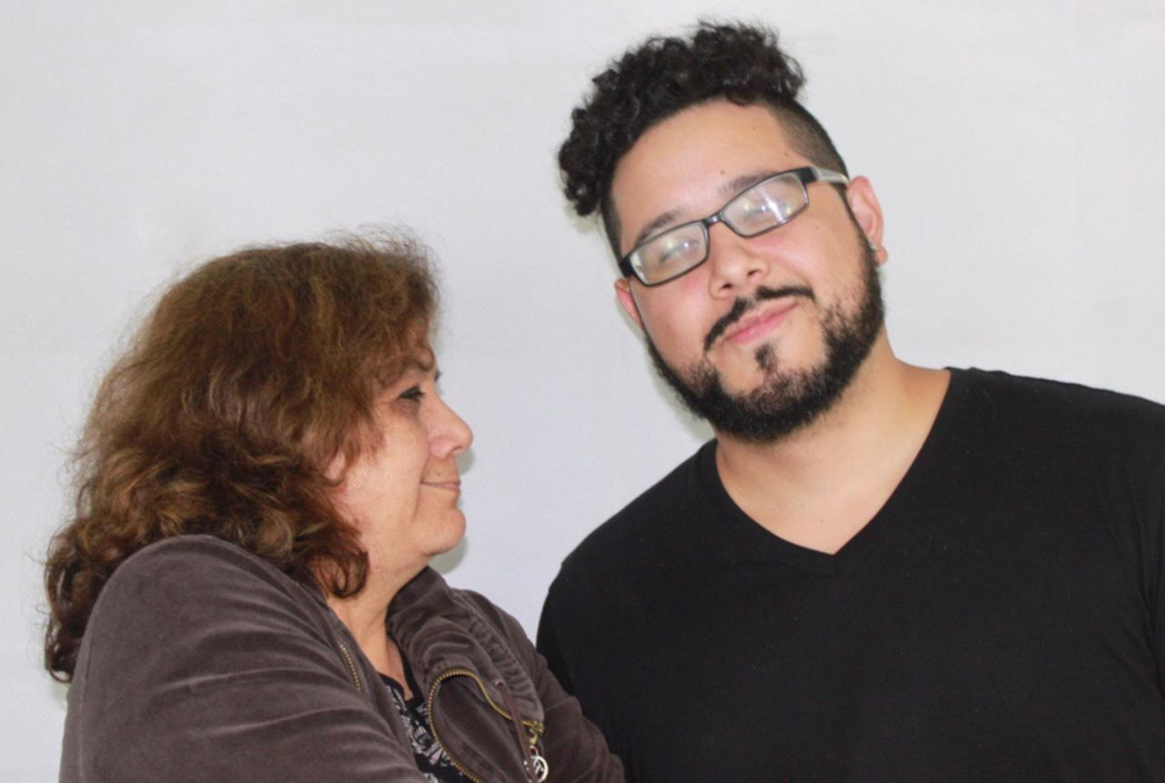 eyeglasses, two people, glasses, headshot, portrait, indoors, togetherness, women, adult, beard, facial hair, people, smiling, males, casual clothing, females, men, lifestyles, emotion, hairstyle, hair, positive emotion, couple - relationship, mature men